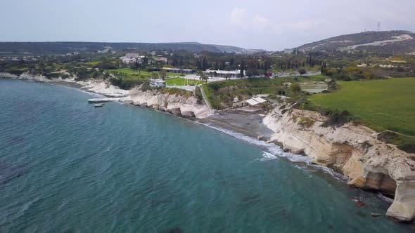 Thumbnail for Aerial View of Blue Sea Water and Black Sand Shore of Resort Area in Cyprus in Cloudy Day