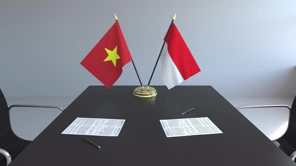 Flags of Vietnam and Indonesia on the Table