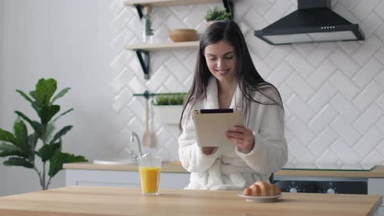 Thumbnail for Happy Girl Using Tablet in Kitchen
