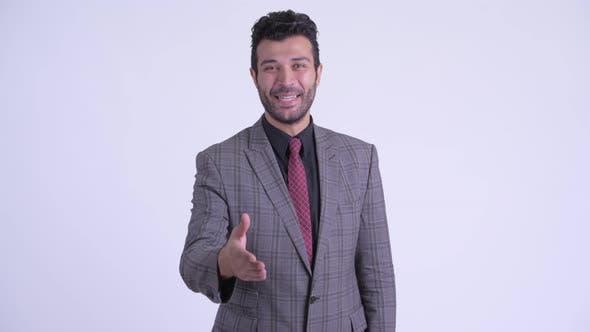 Thumbnail for Happy Bearded Persian Businessman Giving Handshake