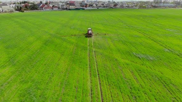 Following Tractor Sprayer in the Field