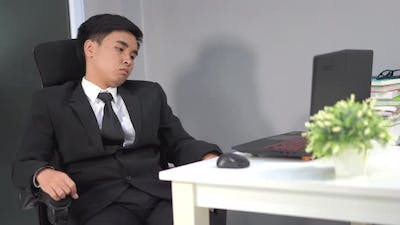 young business man sitting on chair and thinking