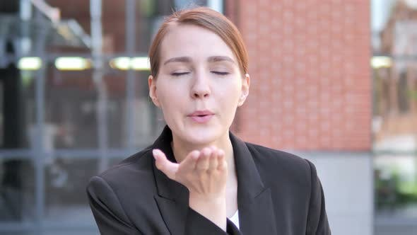 Flying Kiss by Young Businessman Standing Outdoor
