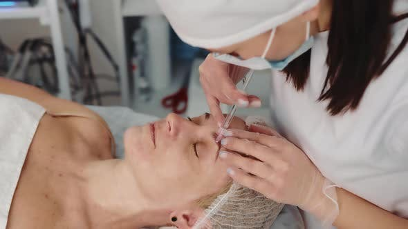 the Beautician Performs a Facelift Procedure