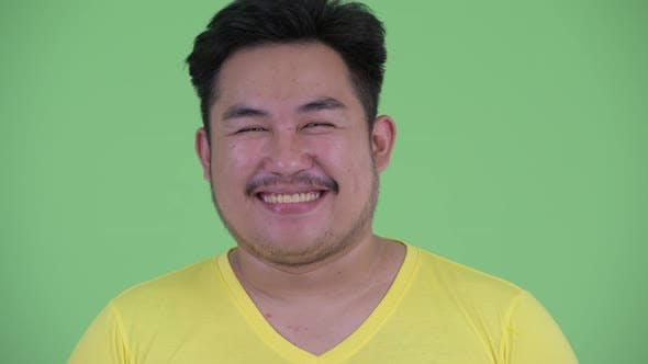 Thumbnail for Face of Happy Young Overweight Asian Man Smiling