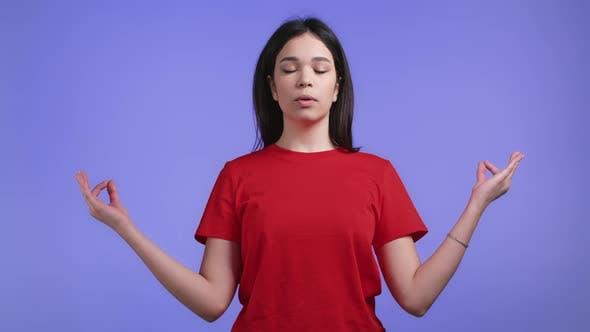 Calm Woman Relaxing Meditating