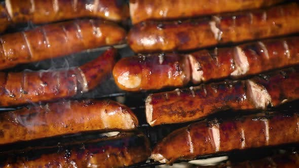 Thumbnail for Delicious Fried Sausages on Home Barbecue