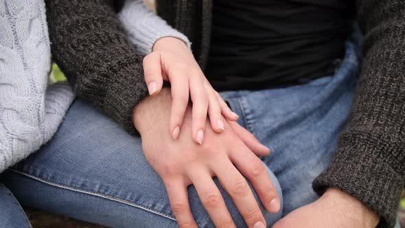 Thumbnail for The Couple of Man and Woman Is Holding Hands Together on Knees