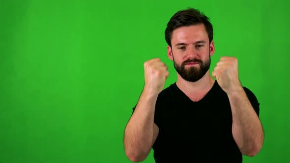 Thumbnail for Young Handsome Bearded Man Rejoices - Green Screen - Studio