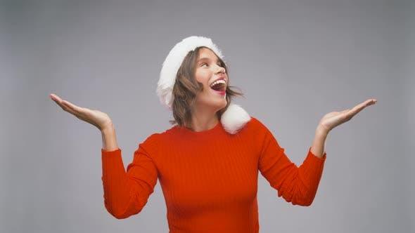 Amazed Woman in Santa Helper Hat on Christmas