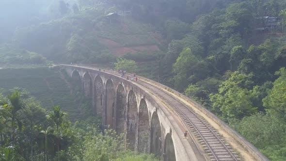 Tourist Enjoy Famous Demodara Bridge in Rainforest