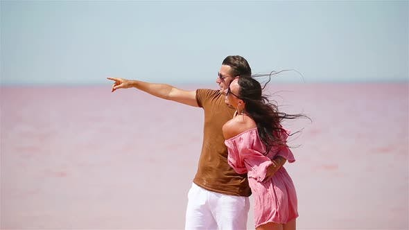 Thumbnail for Family Walk on a Pink Salt Lake on a Sunny Summer Day.