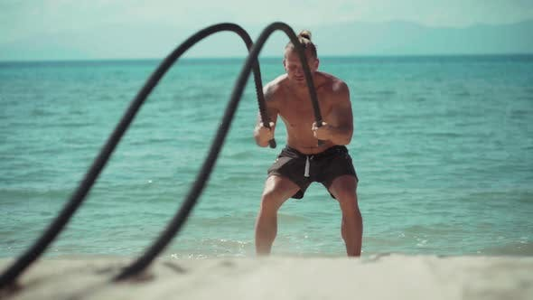 Thumbnail for Man Training with Battle Rope on the Beach