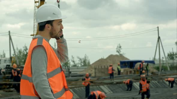 Thumbnail for Construction Worker Talking on the Phone at a Building Site