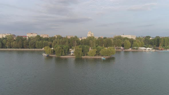 Aerial view of lake and trees near buildings