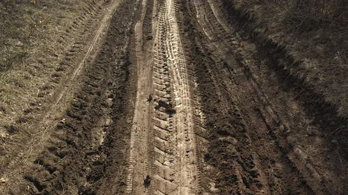 Dirt road with vehicle tire marks 4K drone video
