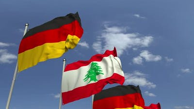 Waving Flags of Lebanon and Germany on Sky Background