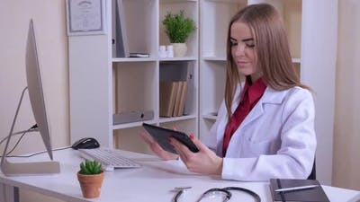 Physician Reads Medical History