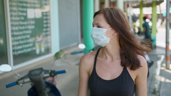 Thumbnail for Woman Wearing a Protective Mask Walking in the City