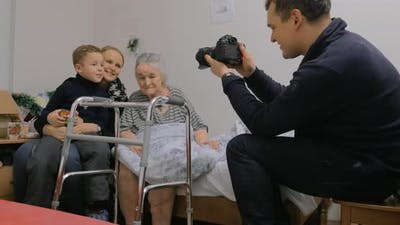 Taking photos with elderly grandma