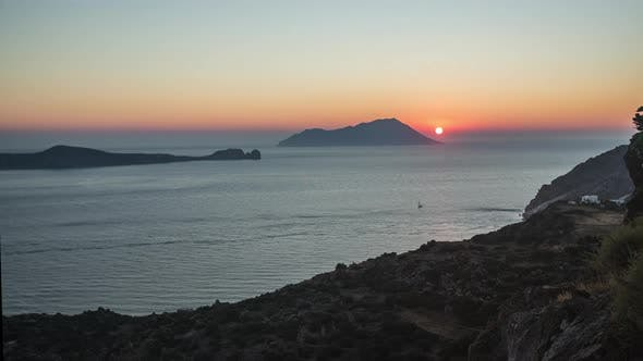 Thumbnail for Golden Hour Sunset Time Lapse of Sun Disappears in Ocean of Greek Island Milos, Greece