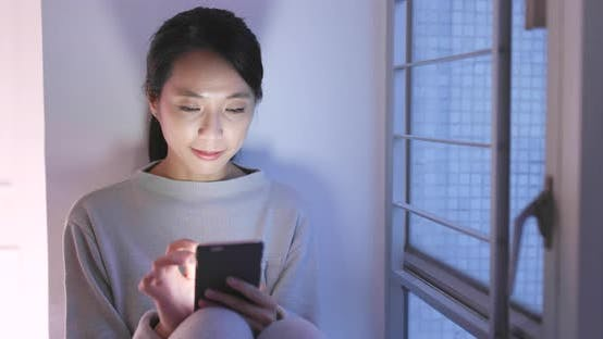 Thumbnail for Woman use of mobile phone at home in the evening