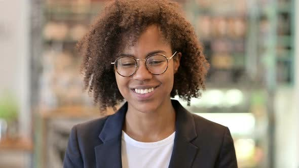 Smiling African Businesswoman Looking at Camera