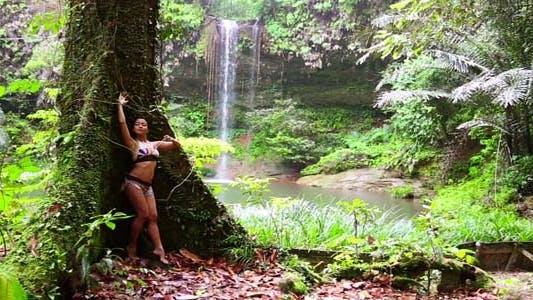 Thumbnail for Girl Leaning Tree In Rainforest Background 2