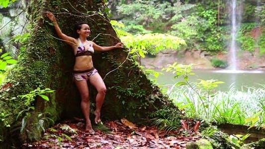 Thumbnail for Girl Leaning Tree In Rainforest Background 3