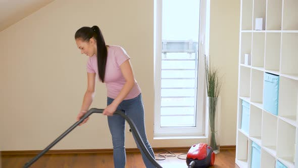 Thumbnail for Woman or Housewife with Vacuum Cleaner at Home 2