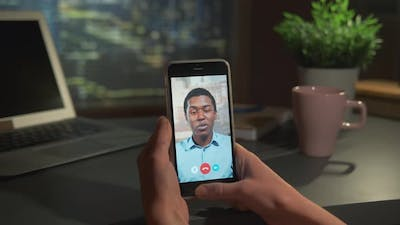 Video Calling with Black Man on Smartphone