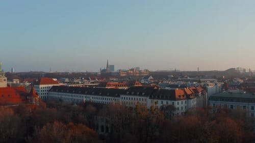 Close Low Flight Above Rooftops of Munich, Germany Towards Maximilianeum Palatial Building in