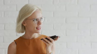 Lady in Glasses Recording Audio Message
