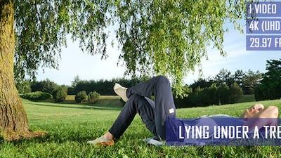 Man Lying Under A Tree