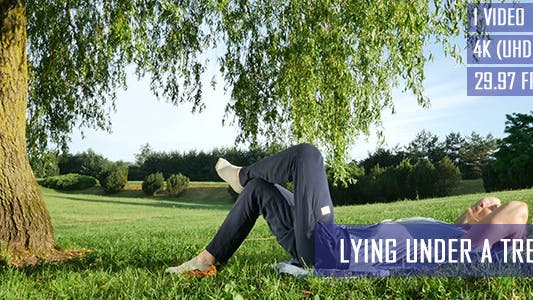 Thumbnail for Man Lying Under A Tree
