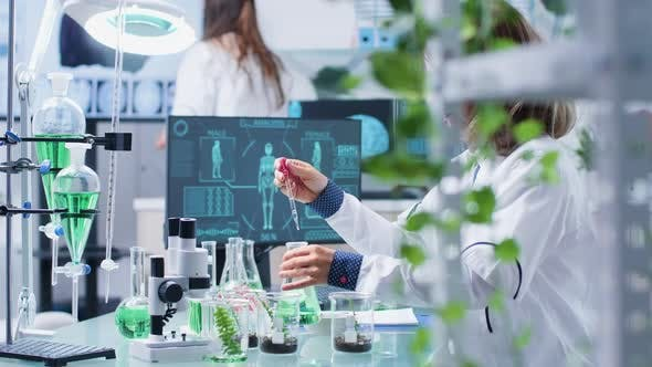 Thumbnail for Female Researcher in Biology Testing New Organic Samples