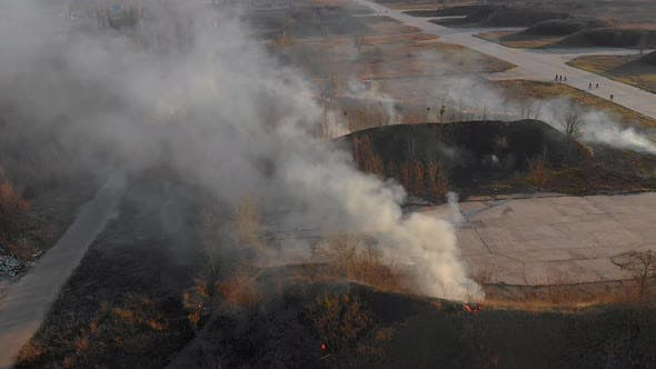 Thumbnail for Aerial Top View of Epic Burning Dry Grass and Trees on a Spring Day Close To the Village at Sunset