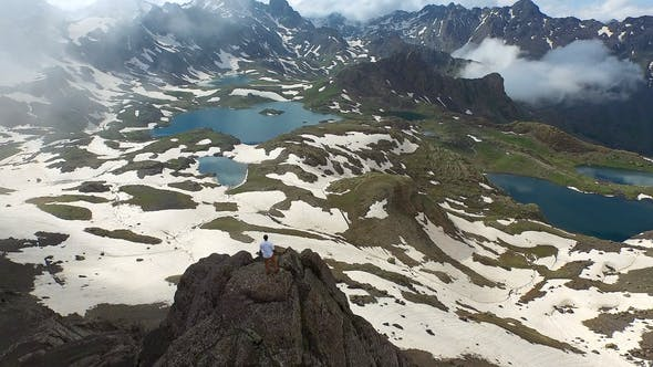 Successful Businessman Watching the Landscape on Mountain Peak