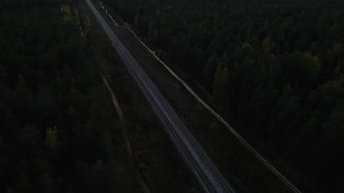 Drone Point of View Over Railroad Revealing City and Lake