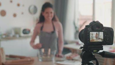 Blurred Vlogger Filming Vlog in Kitchen