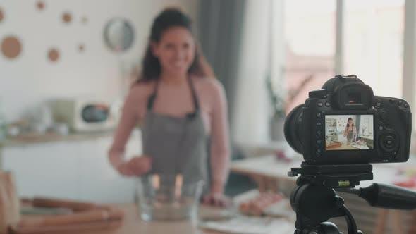Thumbnail for Blurred Vlogger Filming Vlog in Kitchen