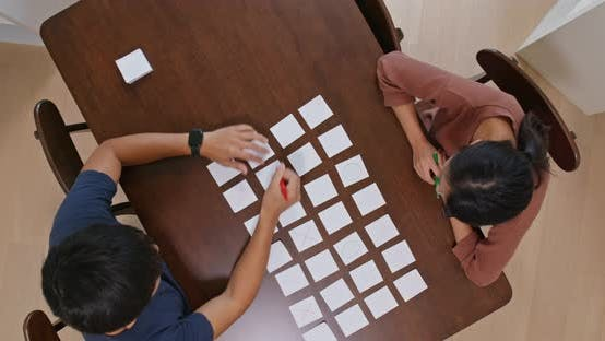 Thumbnail for Couple Discuss the Planning with Memo Paper on The Table