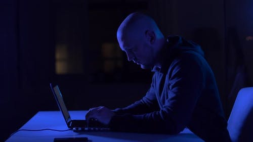 Hacker Using Laptop Computer for Cyber Attack 1