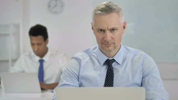 Thumbnail for Thumbs Down By Grey Hair Businessman in Office