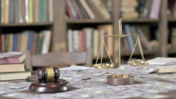 Thumbnail for Money on Court Room Table with Gavel and Scale
