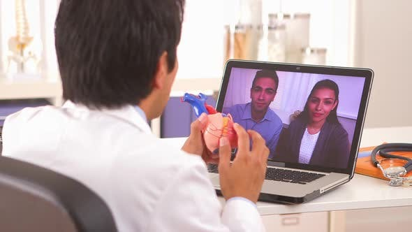Thumbnail for Hispanic doctor reassuring couple of positive results