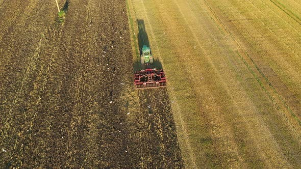 Thumbnail for Tractor Cultivating Earth After Harvesting