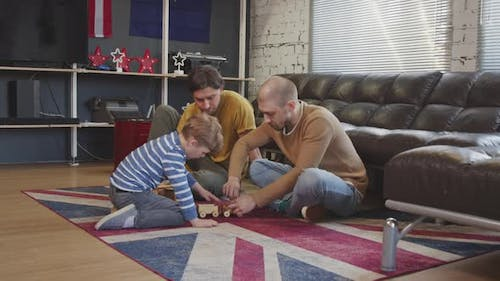 LGBTQ Family with Kid Playing with Toys