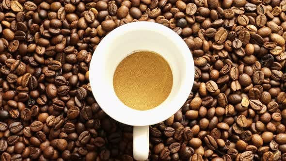 Cover Image for Soluble Coffee On The Background Of Coffee Grains