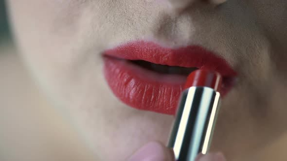 Thumbnail for Obese Female Applying Red Lipstick and Preparing for Date With Boyfriend